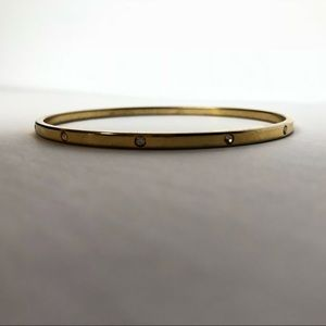 Jewelry - Gold bangle with rhinestones around